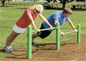 Image of people exercising using an outdoor exercise structure