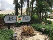 Image of a welcome sign for the Les Jardins Palm Ridge community at Woodmont.