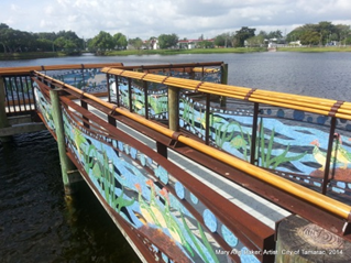 Mural paintings on the walls of a bridge above water