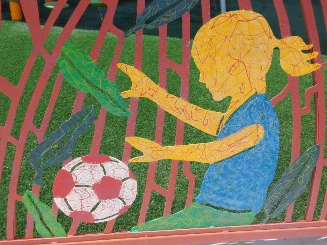 A mural painting of a girl playing soccer