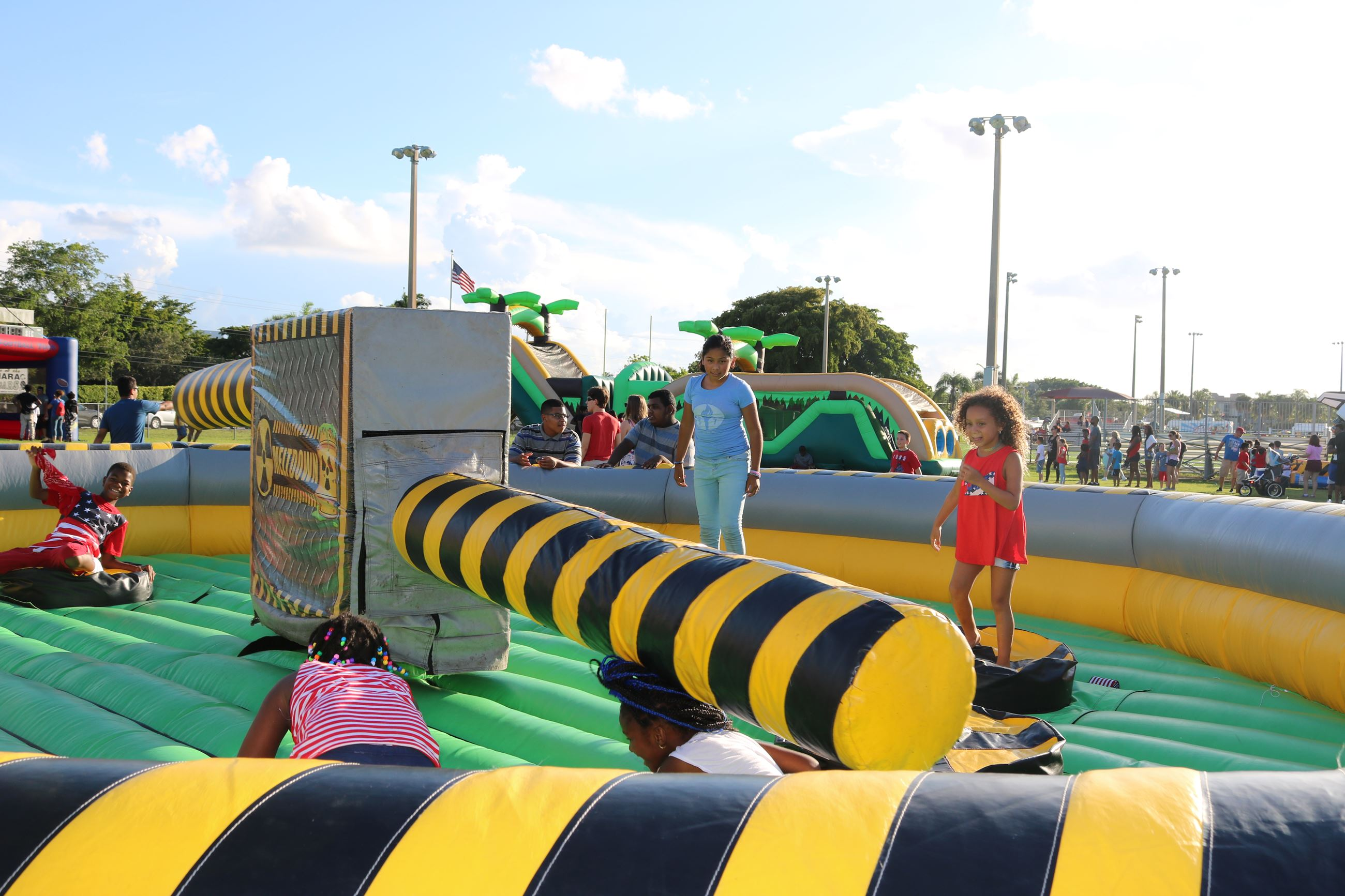 Children play on an inflatable ride at July 4th event.